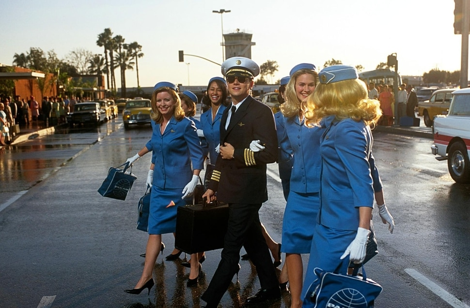 Leonardo DiCaprio (center) plays Frank Abagnale, a con artist who used the guise of a Pan Am pilot as one of his tricks, in the 2002 caper movie Catch Me If You Can. (Photo courtesy Dreamworks SKG)