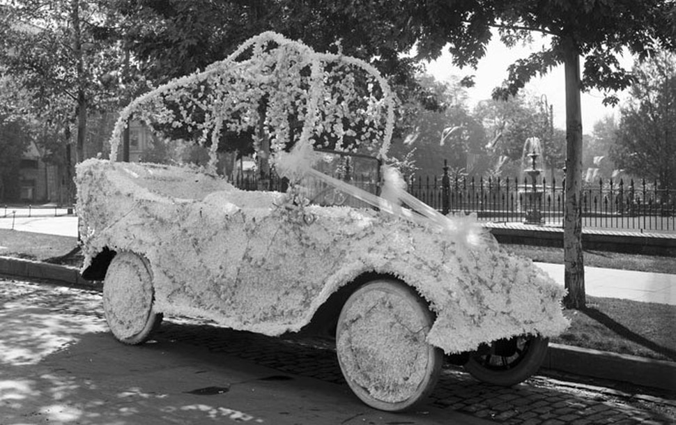(Photo courtesy of Utah State History) An automobile is decorated for the 1916 Pioneer Day parade in Salt Lake City. It was the last year the parade was held before the United States entered World War I. The parade was canceled in 1917 and 1918, because of the war.