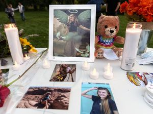 (Leah Hogsten   The Salt Lake Tribune) Pictures of Gabby Petito, candles and flowers adorn a table at a vigil at Sugarhouse Park, Sept. 22, 2021 in her honor. Petito, the missing 22-year-old whose remains were found Tuesday in the area of the Spread Creek Dispersed Camping Area of Bridger-Teton National Forest on the east boundary of Grand Teton National Park.