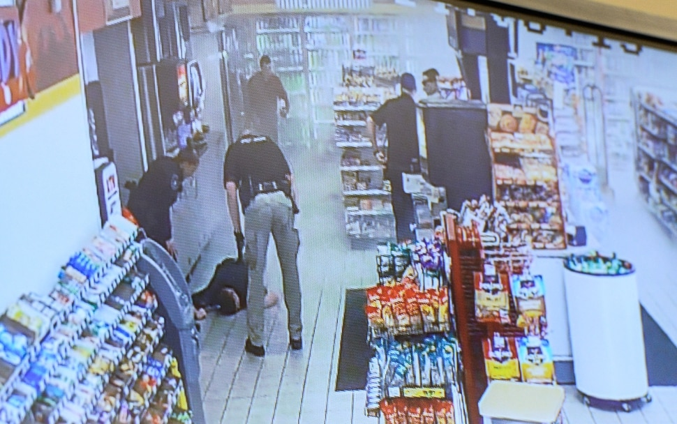 (Francisco Kjolseth | The Salt Lake Tribune) Kaysville Officer Robert Jackson lies on the floor of a convenience store gas station after a suicidal subject lit himself on fire on April 5, 2018, subsequently burning several officers who were trying to calm him down. The Kaysville police department aired the surveillance footage during a press event featuring the officers involved, including Jackson who appeared by video as he recovers from his injuries at University hospital.