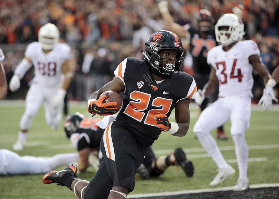 (Timothy J. Gonzalez | AP file photo) Oregon State running back Jermar Jefferson (22) scores a touchdown during an NCAA college football in Corvallis, Ore., on Oct. 6, 2018.