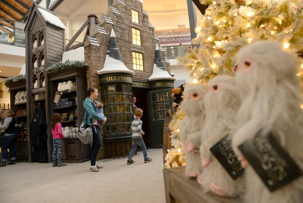 (Al Hartmann | The Salt Lake Tribune) Folks get a sneak peek Thursday, Nov. 9, of Warner Bros. Harry Potter-themed exhibit and shopping area in the Shops at South Town in Sandy. There are interactive activities in addition to Harry Potter and Fantastic Beasts and Where to Find Them merchandise.