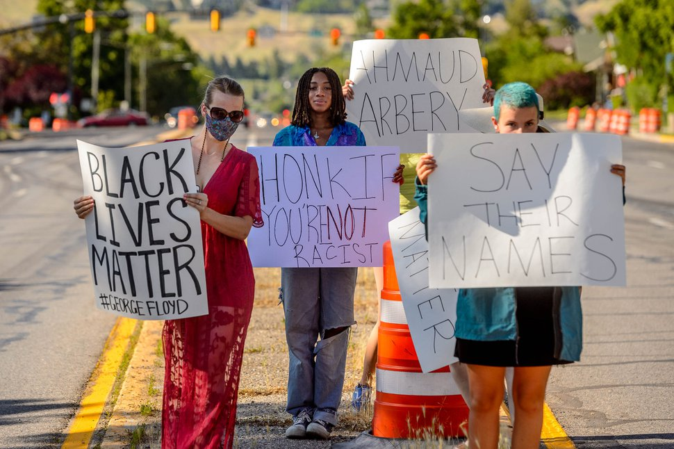 (Trent Nelson | The Salt Lake Tribune) People protest police brutality, holding signs up to passing traffic on 1300 East in front of the First Unitarian Church in Salt Lake City on Friday, May 29, 2020.