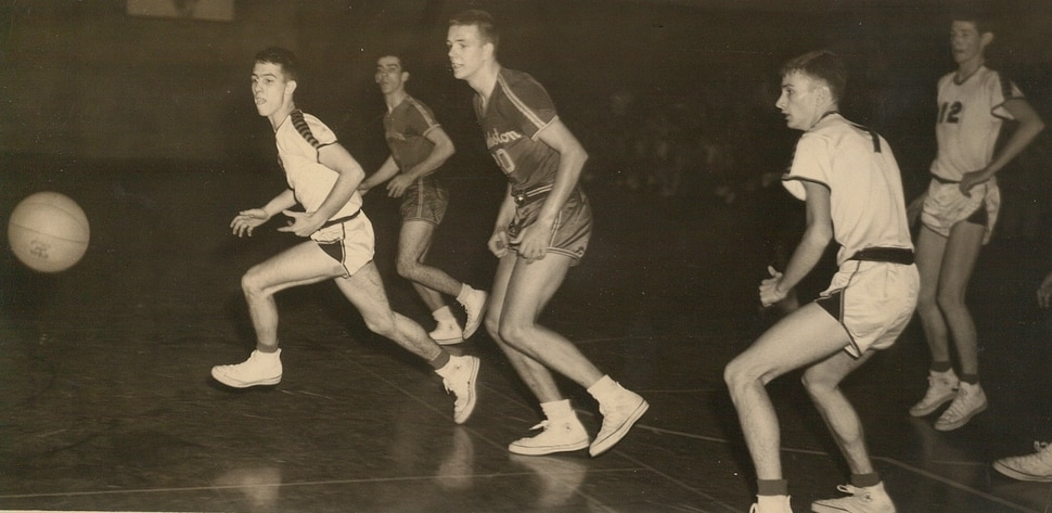 (Photo courtesy of the Hundley family) Hot Rod Hundley (center) in action for Charleston High School in West Virginia.