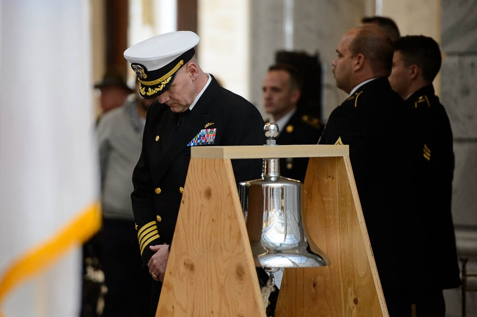 (Trent Nelson | The Salt Lake Tribune) Captain Todd Vandergrift rings the Bennion Bell, named after Captain Mervyn Bennion, a veteran of World War 1, who died at Pearl Harbor. Commemoration of WW1 Armistice 100th Anniversary, in Salt Lake City on Thursday Nov. 8, 2018.