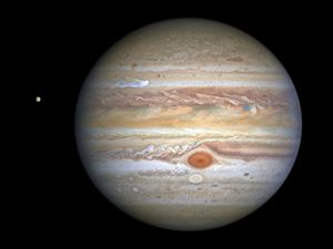 (NASA, ESA, STScI, A. Simon, M. via AP) This Aug 25, 2020, image captured by NASA's Hubble Space Telescope shows the planet Jupiter and one of its moons, Europa, at left, when the planet was 406 million miles from Earth.
