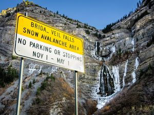 (Isaac Hale | The Daily Herald file photo via AP) Water cascades down Bridal Veil Falls in Provo Canyon, Utah, Dec. 1, 2020. A developer who wanted to buy part of the property and build a high-end treatment lodge at the top and a tram has dropped his lawsuit against Utah County for blocking his plans.