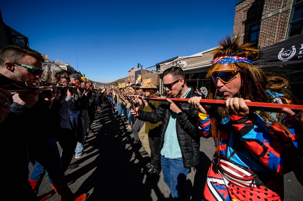 (Trent Nelson | The Salt Lake Tribune) Participants line Park City's Historic Main Street to throw one back at the annual Shot Ski event on Saturday Oct. 12, 2019.