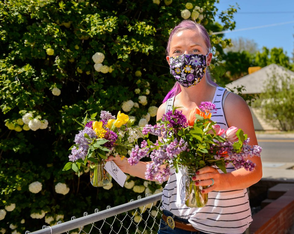 (Trent Nelson | The Salt Lake Tribune) Anna Zack, co-founder of Zack Family Farms, makes Mother's Day deliveries in Ogden on Saturday, May 9, 2020. Anna and Ben Zack started Zack Family Farms last fall with hopes of selling flowers to florists for weddings. But during COVID-19, they had to adapt and are now making home deliveries with their flowers.