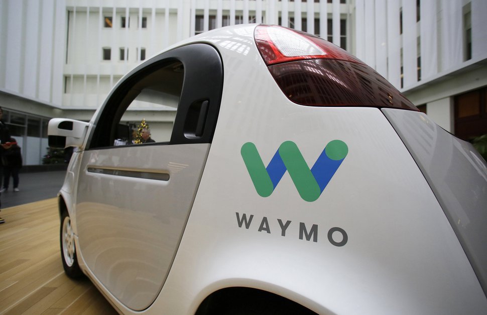 FILE - In this Dec. 13, 2016, file photo, the Waymo driverless car is displayed during a Google event in San Francisco. Uber is settling a lawsuit filed by Google's autonomous car unit alleging that the ride-hailing service ripped off self-driving car technology. Both sides in the case issued statements confirming the settlement Friday, Feb. 9, 2018, morning in the midst of a federal court trial in the case. (AP Photo/Eric Risberg, File)