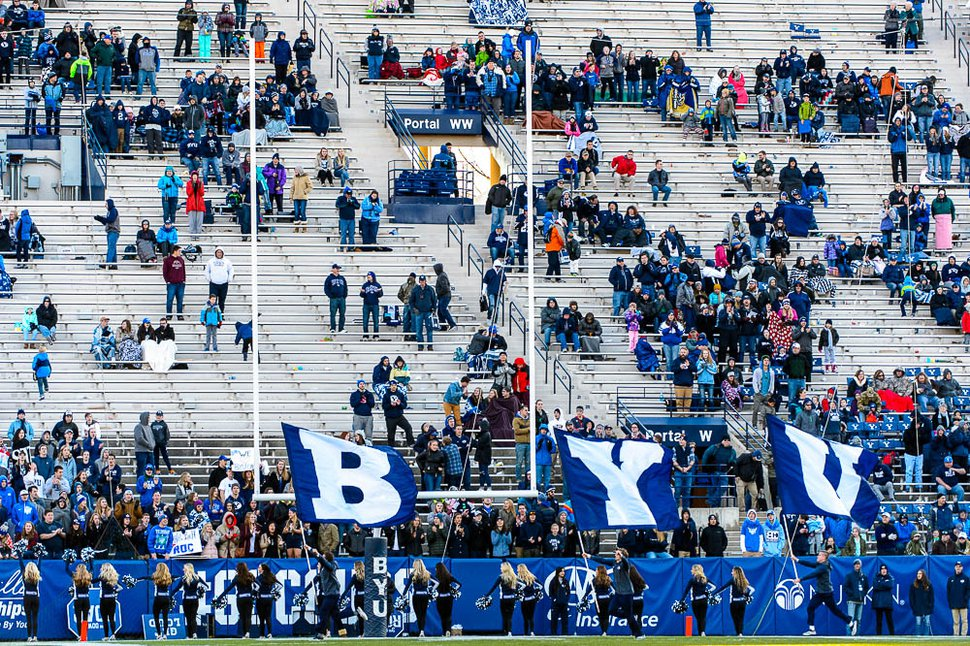 (Trent Nelson | The Salt Lake Tribune) BYU fans celebrate a late touchdown as BYU hosts the University of Massachusetts, NCAA football in Provo, Saturday November 18, 2017.