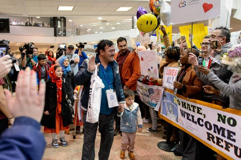 (Photo courtesy of Catholic Community Services) Refugees arrive at the Salt Lake City airport with volunteers from Catholic Community Services.