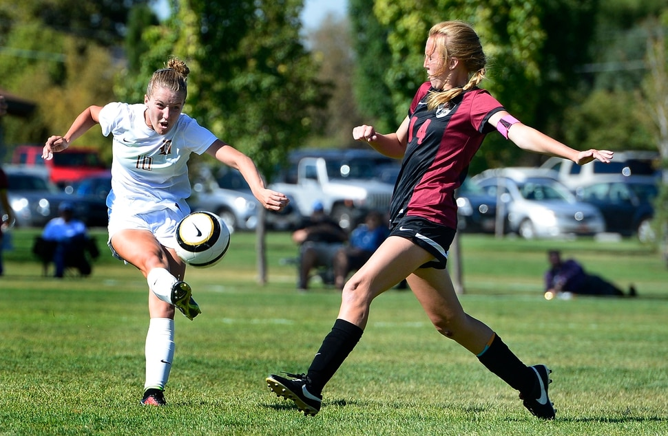 (Scott Sommerdorf | Tribune File Photo) Davis' Olivia Wade lets rip with a shot as Viewmont's Grace Johnson defends during first half play. Davis defeated Viewmont 5-2, Thursday, September 10, 2015.