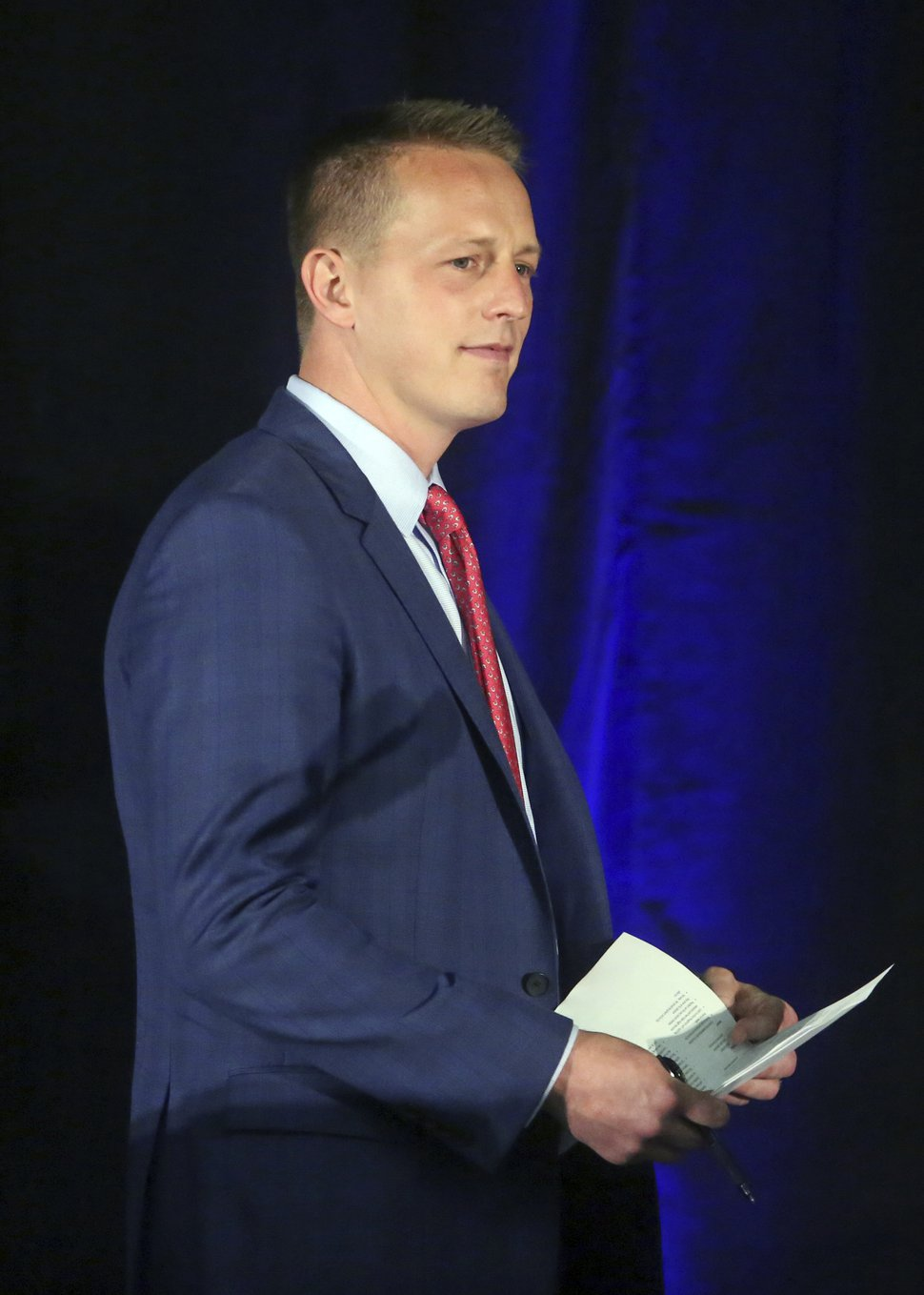 Republican candidate Tanner Ainge walks on stage during a debate at the Utah Valley Convention Center Friday, July 28, 2017, in Provo, Utah. Republican candidates, John Curtis, Chris Herrod and Ainge, vying for the seat vacated by U.S. Rep. Jason Chaffetz, debated on topics ranging from healthcare to religious freedom. (AP Photo/Rick Bowmer)