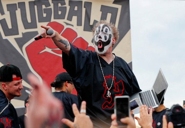 (Pablo Martinez Monsivais | The Associated Press) Violent J, a member of the rap group Insane Clown Posse, yells on stage before speaking to juggalos, as supporters of the group are known, in front of the Lincoln Memorial in Washington during a rally, Saturday, Sept. 16, 2017, to protest and demand that the FBI rescind its classification of the juggalos as