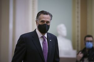 (J. Scott Applewhite | AP photo) Sen. Mitt Romney, R-Utah, returns to the chamber from a short break as House impeachment managers present their second day of arguments in the Senate trial of former President Donald Trump, at the Capitol in Washington, Thursday, Feb. 11, 2021.