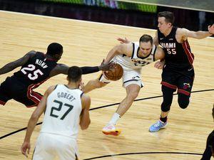 Utah Jazz forward Bojan Bogdanovic, center, drives to the basket as Miami Heat guard Kendrick Nunn (25) and guard Duncan Robinson (55) defend during the second half of an NBA basketball game, Friday, Feb. 26, 2021, in Miami. (AP Photo/Lynne Sladky)