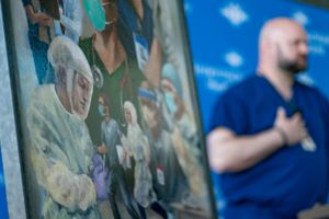 (Francisco Kjolseth  | Salt Lake Tribune file photo) Intermountain Healthcare emergency department nurse Jay Larsen talks about a challenging year and working with a team of dedicated colleagues during an unveiling of new artwork by Utah artist Heather Olsen, that pays tribute to frontline health care workers during the COVID-19 pandemic, Monday, April 5, 2021, in Murray.