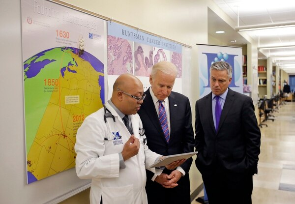Dr. Jewel Samadder, left, speaks with Vice President Joe Biden as former Utah Gov. Jon M. Huntsman looks on during a tour of the research lab at the Huntsman Cancer Institute Friday, Feb. 26, 2016, in Salt Lake City, as part of the White House's cancer
