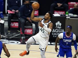 Utah Jazz guard Donovan Mitchell (45) shoots past Los Angeles Clippers guard Reggie Jackson (1) during the first half of an NBA basketball game Wednesday, Feb. 17, 2021, in Los Angeles. (AP Photo/Marcio Jose Sanchez)