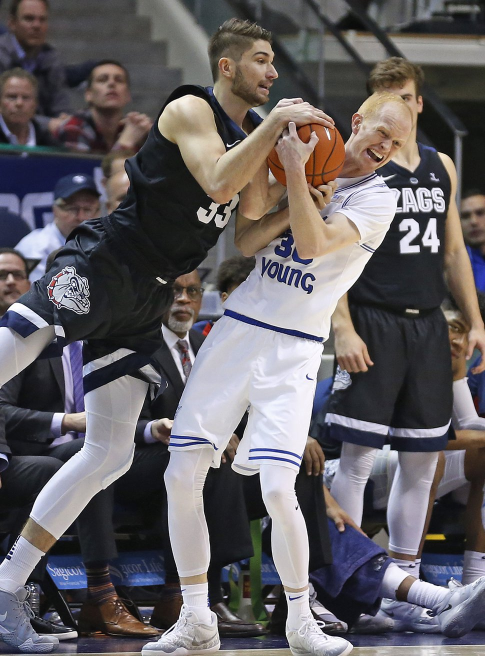 Gonzaga forward Killian Tillie (33) and BYU guard TJ Haws, right, vie for the ball during the second half of an NCAA college basketball game Thursday, Jan. 31, 2019, in Provo, Utah. (AP Photo/Rick Bowmer)