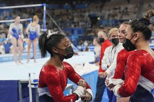 (Gregory Bull | AP) Simone Biles, of the United States, talks to teammate Sunisa Lee during the artistic gymnastics women's final at the 2020 Summer Olympics, Tuesday, July 27, 2021, in Tokyo.