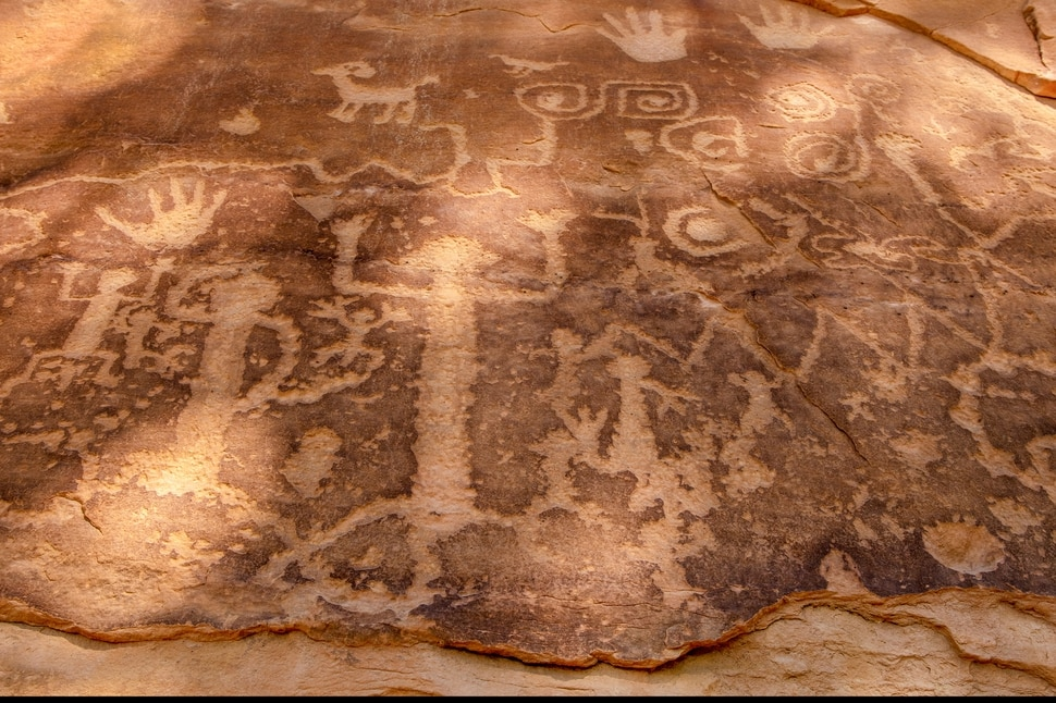 Petroglyphs at the end of the end of the Petroglyph Trail, in Chapin Mesa, Mesa Verde National Park in New Mexico on Aug. 20, 2019. In the red rock desert of the Southwest, an ancient culture was thought to have vanished but a new view connects it to pueblo dwellers of today. (John Burcham/The New York Times)