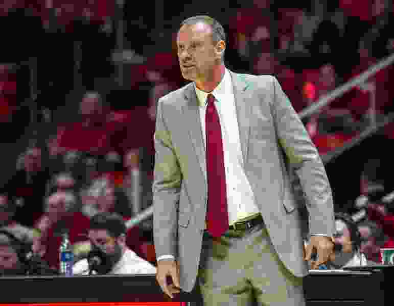 Ute athletic director Mark Harlan is 'very bullish' about Larry Krystkowiak's basketball program, labeling him 'an elite coach'