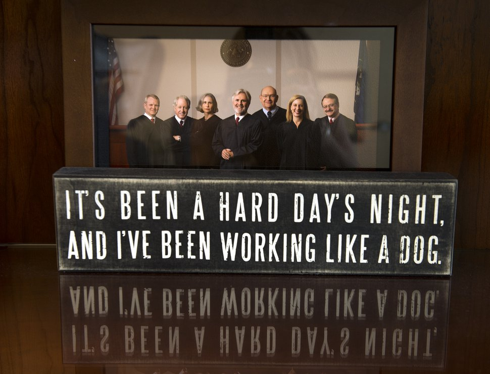 Leah Hogsten | The Salt Lake Tribune Utah Court of Appeals judge Frederic Voros' desk displays a photo of the he and other members of the Utah Appellate Court along with a quote from the Beatles' song
