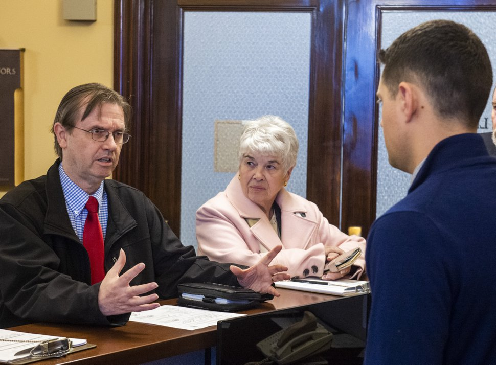 (Rick Egan | Tribune file photo). Former State Rep. Fred Cox, and Judy Weeks Rohner file paperwork to start signature gathering on an initiative seeking to allow voters to reject the tax reform law, at Lt. Governor's office, Monday, Dec. 16, 2019.