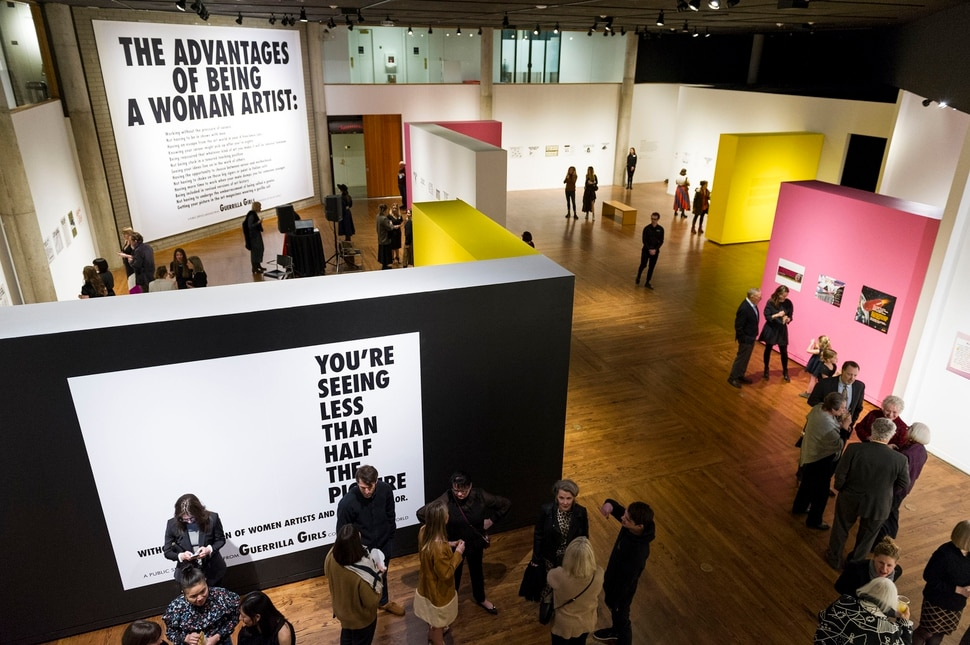 (Alex Gallivan | Special to The Tribune) People tour the Guerrilla Girls exhibit at the Utah Museum of Contemporary Art on Wednesday, Feb 5, 2020.