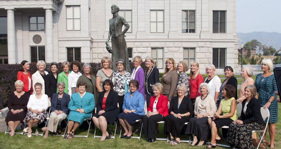 Steve Griffin | The Salt Lake Tribune Current and former women Utah legislators (front row) Peggy Wallace, Beverly White, Karen Shepherd, Olene Walker, Becky Lockhart, Margaret Dayton, Chris Fox Finlinson, Carol Spackman Moss, Paula Julander, Alicia Suazo and Karen Morgan. (Back row) Nancy Lyon, Carlene Walker, Patrice Arent, Lou Shurtliff, Trisha Beck, Rhonda Menlove, Sheryl Allen, Merlynn Newbold, Becky Edwards, Marie Poulson, Jennifer Seelig, Jackie Biskupski, Christine Watkins, Karen Mayne, Rebecca Chavez Houck, Darlene Gubler and Pat Jones pose for a photograph with the Martha Hughes Cannon statue outside the state capitol in Salt Lake City, Utah Wednesday August 15, 2012. The women gathered at the capitol for a screening of the KUED documentary on Martha Hughes Cannon who was the first women state senator in the United States.