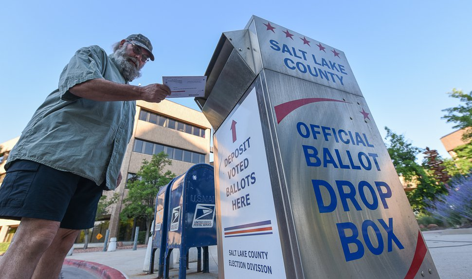 (Francisco Kjolseth | The Salt Lake Tribune) Dave Sawatzki drops his election ballot in the official drop box at the Salt Lake County complex for primary election day on Tuesday, June 26, 2018.