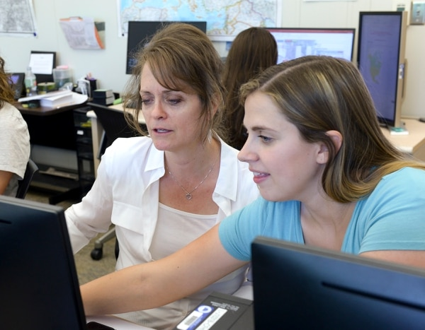 Leah Hogsten | The Salt Lake Tribune l-r Brigham Young University research fellow Lisa Stokes and graduate Melanie Torres research genealogy files at BYUÕs BYU Center for Family History and Genealogy, Thursday, June 21, 2018. Stokes and Torres have been bringing closure for families and loved ones of missing soldiers from conflicts as far back as WWII with the help of the Army and the Defense POW/MIA Accounting Agency (DPAA) to return the remains of missing soldiers to their family members. Students start with a soldier's DNA and then search for the closest living relative.