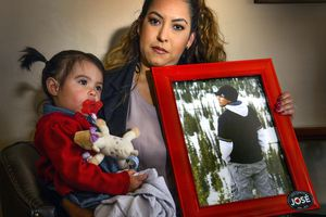 (Steve Griffin  |  The Salt Lake Tribune)  Griselle Trujillo with her 19-month-old daughter Luna Faith Fernandez, holds a photograph of her husband Jose Fernandez, in Heber Tuesday April 24, 2018. He was killed by an acquaintance with a handgun after an evening of drinking.