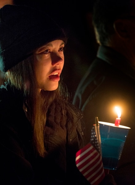 (Rick Egan | The Salt Lake Tribune) Krystal Carter sings along with the crowd, during a candlelight vigil for Brent Taylor, in North Ogden. Taylor, a major in the National Guard, was killed Saturday in an insider attack in Kabul, Afghanistan. Wednesday, Nov. 7, 2018.