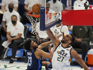 Utah Jazz center Rudy Gobert (27) dunks in front of Oklahoma City Thunder center Tony Bradley (13) in the first half of an NBA basketball game Friday, May 14, 2021, in Oklahoma City. (AP Photo/Sue Ogrocki)