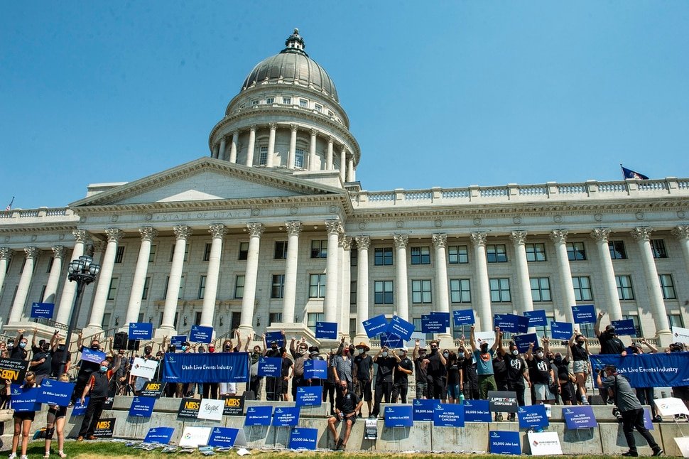 (Rick Egan | The Salt Lake Tribune) More than 100 members of Utah Live Events Industry Association march to the State Capitol in a silent march to call attention to the state of their industry, on Tuesday, July 21, 2020.