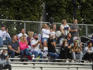 (Rick Egan  |  The Salt Lake Tribune)    Riverton High fans cheer for the Silverwolves as they play the Jordan High Beet Diggers on Friday, Sept. 18, 2020. Spikes in COVID-19 cases at high schools have been linked to social gatherings and extracurricular activities, like football games, which could be halted if numbers continue to climb.