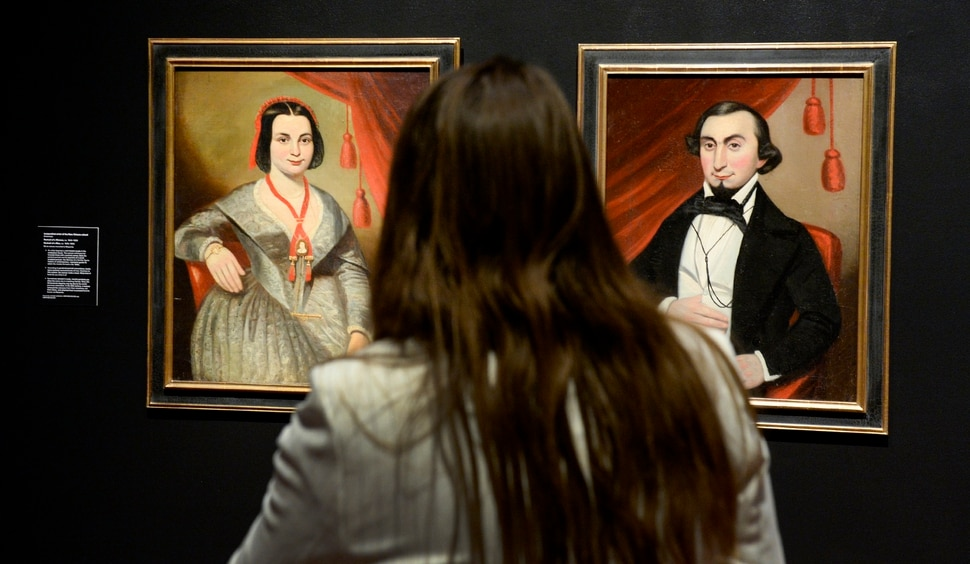 (Leah Hogsten | The Salt Lake Tribune) l-r Portrait of a Woman and Portrait of a Man, ca. 1840-1850, oil on canvas mounted to masonite by an Unidentified artist of the New Orleans school. The two portraits depict Ôa well-heeled couple in the antebellum South.Õ Utah Museum of Fine Art curator of European, American, and regional art Leslie Anderson conceived and planned the new exhibit: Power Couples: The Pendant Format in Art, open now through December 8, 2019. ÒPower Couples explores how artists have used the pendant format across media, cultures and time periods to explore gender roles and social status; to present moments of before-and-after, cause-and-effect and departure-and-return; and to compare and contrast familiar stories and ideas.Ó -UMFA