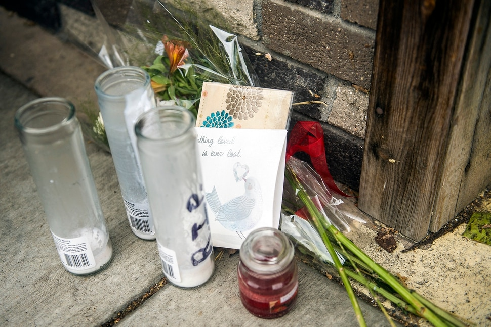 (Chris Detrick | The Salt Lake Tribune) Flowers, cards and candles are left outside of Big Ed's, 210 University Street, in Salt Lake City Tuesday, September 19, 2017.