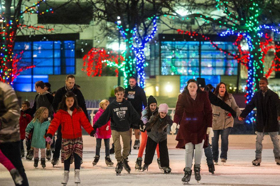 (Chris Detrick | Tribune file photo) Visitors ice skate at the Gallivan Center on Nov. 25, 2016.
