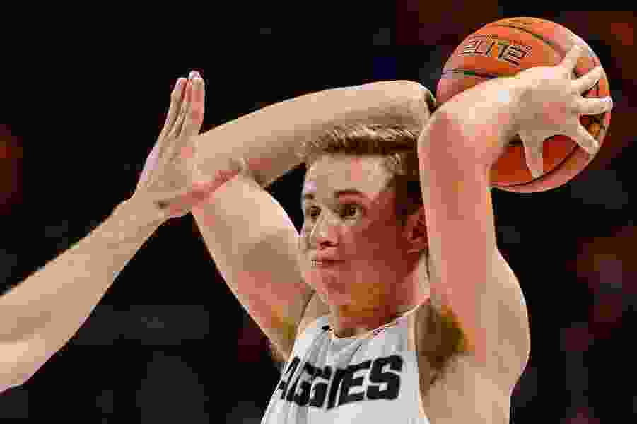 Utah State wins at Wyoming, 71-55, for first time since 1962